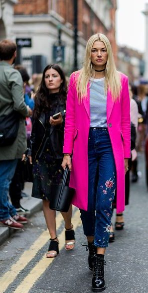 LONDON, ENGLAND - SEPTEMBER 18: Australian model Jessica Hart wearing a pink wool coat, dark denim jeans with patches, bucket bag and blue white striped tshirt outside Topshop during London Fashion Week Spring/Summer collections 2017 on September 18, 2016 in London, United Kingdom. (Photo by Christian Vierig/Getty Images) *** Local Caption *** Jessica Hart
